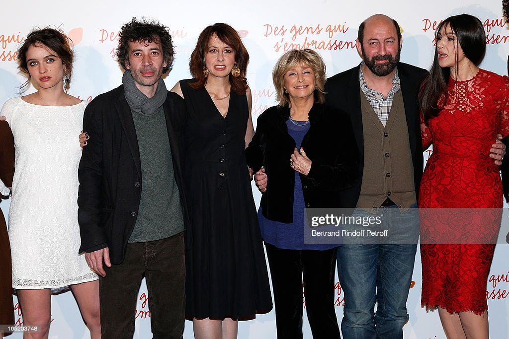 Actress Clara Ponso, Actor Eric Elmosnino, Actress Valerie Bonneton, Director Daniele Thompson, Actor Kad Merad and Actress Monica Bellucci attend 'Des gens qui s'embrassent' movie premiere at Cinema Gaumont Marignan on April 1, 2013 in Paris, France.