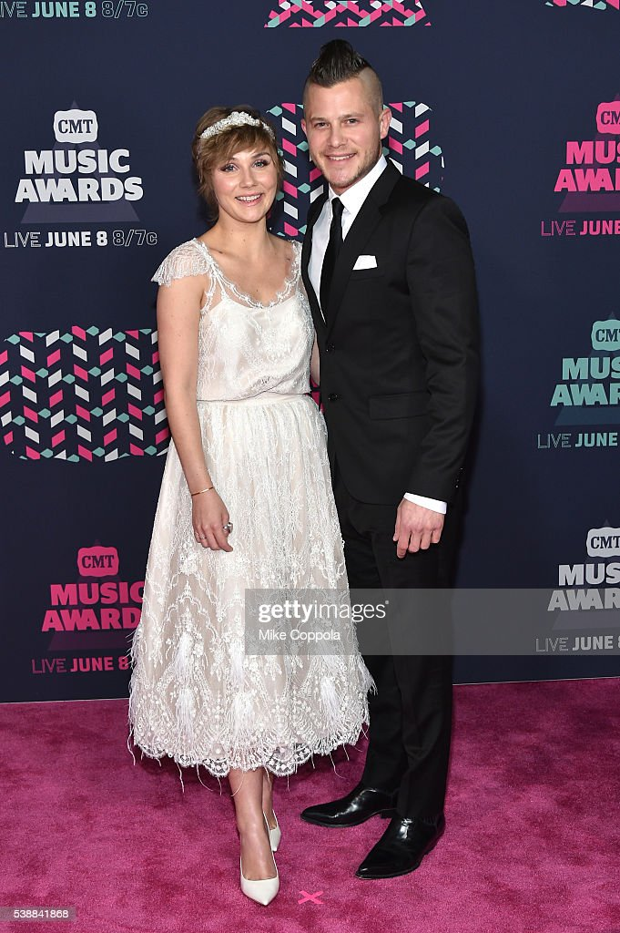 Actress Clare Bowen and fiance Brandon Robert Young attends the 2016 CMT Music awards at the Bridgestone Arena on June 8 2016 in Nashville Tennessee