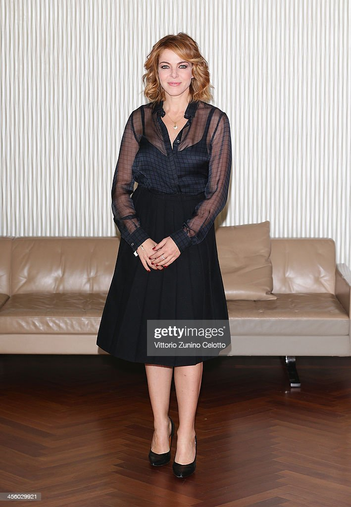 Actress <a gi-track='captionPersonalityLinkClicked' href=/galleries/search?phrase=Claudia+Gerini&family=editorial&specificpeople=220347 ng-click='$event.stopPropagation()'>Claudia Gerini</a> attends 'Indovina Chi Viene A Natale' photocall on December 13, 2013 in Milan, Italy.