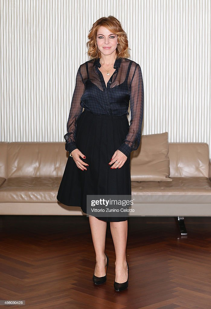 Actress Claudia Gerini attends 'Indovina Chi Viene A Natale' photocall on December 13, 2013 in Milan, Italy.