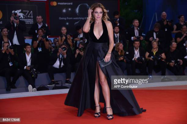 Actress Claudia Gerini attends the premiere of the movie 'Ammore E Malavita' presented in competition at the 74th Venice Film Festival on September 6...