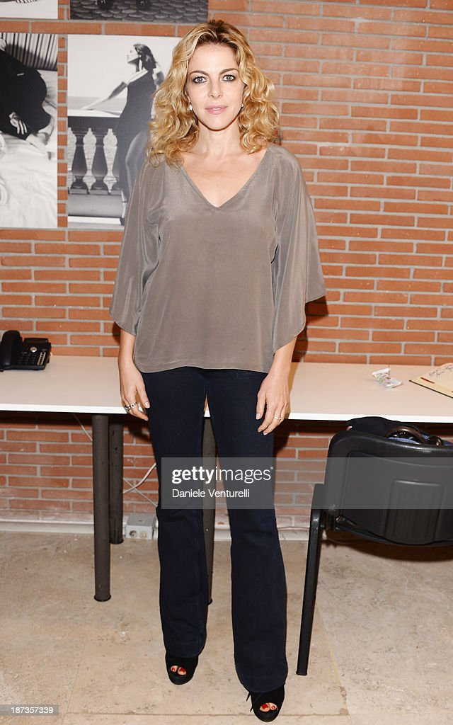 Actress <a gi-track='captionPersonalityLinkClicked' href=/galleries/search?phrase=Claudia+Gerini&family=editorial&specificpeople=220347 ng-click='$event.stopPropagation()'>Claudia Gerini</a> attends the Rome Film Festival Opening Press Conference during the 8th Rome Film Festival at the Auditorium Parco Della Musica on November 8, 2013 in Rome, Italy.