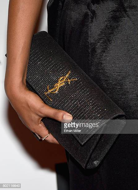 Actress Claudia Jordan clutch detail attends the 2015 Miss Universe Pageant at Planet Hollywood Resort Casino on December 20 2015 in Las Vegas Nevada