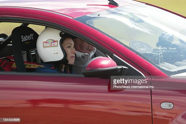 Actress Claudia Karvan test drives a car during filming for the new series of Top Gear Australia at Camden Airport on October 22 2008 in Sydney...