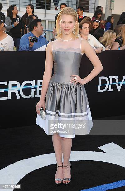 Actress Claudia Lee arrives at the Los Angeles Premiere 'Divergent' at Regency Bruin Theatre on March 18 2014 in Los Angeles California