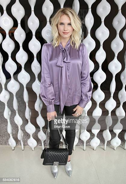 Actress Claudia Lee attends the Wolk Morais Collection 3 Fashion Show on May 24 2016 in Los Angeles California