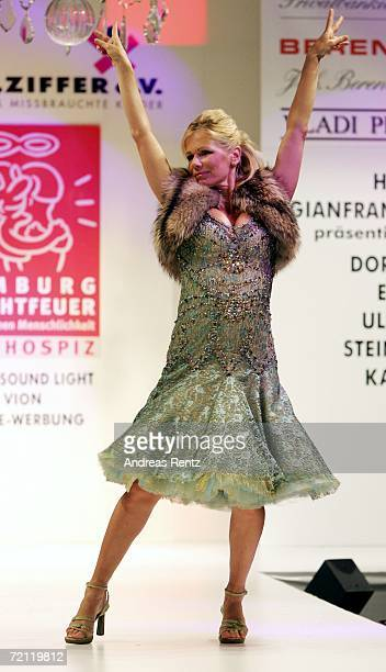 Actress Claudine Wilde walks down the runway at the Prominent Fashion Gala on September 8 2006 in Hamburg Germany