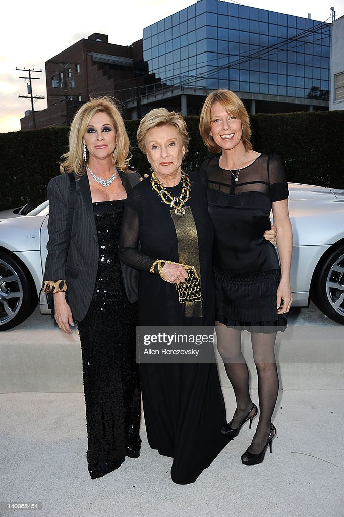 Actress <a gi-track='captionPersonalityLinkClicked' href=/galleries/search?phrase=Cloris+Leachman&family=editorial&specificpeople=204686 ng-click='$event.stopPropagation()'>Cloris Leachman</a> (C) and guests arrive at Audi Arrivals at 20th annual Elton John AIDS Foundation Academy Awards viewing party on February 26, 2012 in Beverly Hills, California.