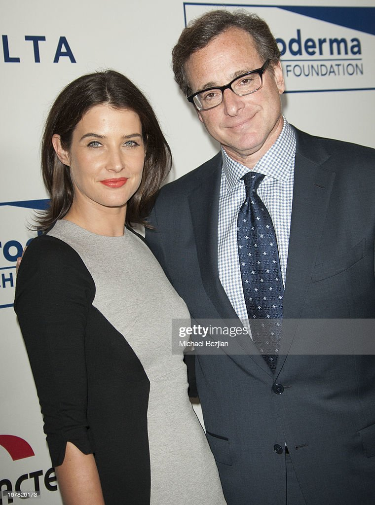 Actress <a gi-track='captionPersonalityLinkClicked' href=/galleries/search?phrase=Cobie+Smulders&family=editorial&specificpeople=739940 ng-click='$event.stopPropagation()'>Cobie Smulders</a> and actor/comedian <a gi-track='captionPersonalityLinkClicked' href=/galleries/search?phrase=Bob+Saget&family=editorial&specificpeople=209388 ng-click='$event.stopPropagation()'>Bob Saget</a> walk the red carpet at Scleroderma Research Foundation's Cool Comedy - Hot Cuisine at Regent Beverly Wilshire Hotel on April 30, 2013 in Beverly Hills, California.