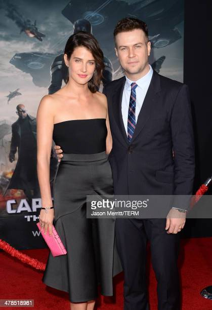 Actress Cobie Smulders and husband actor Taran Killam arrives for the premiere of Marvel's 'Captain America The Winter Soldier' at the El Capitan...