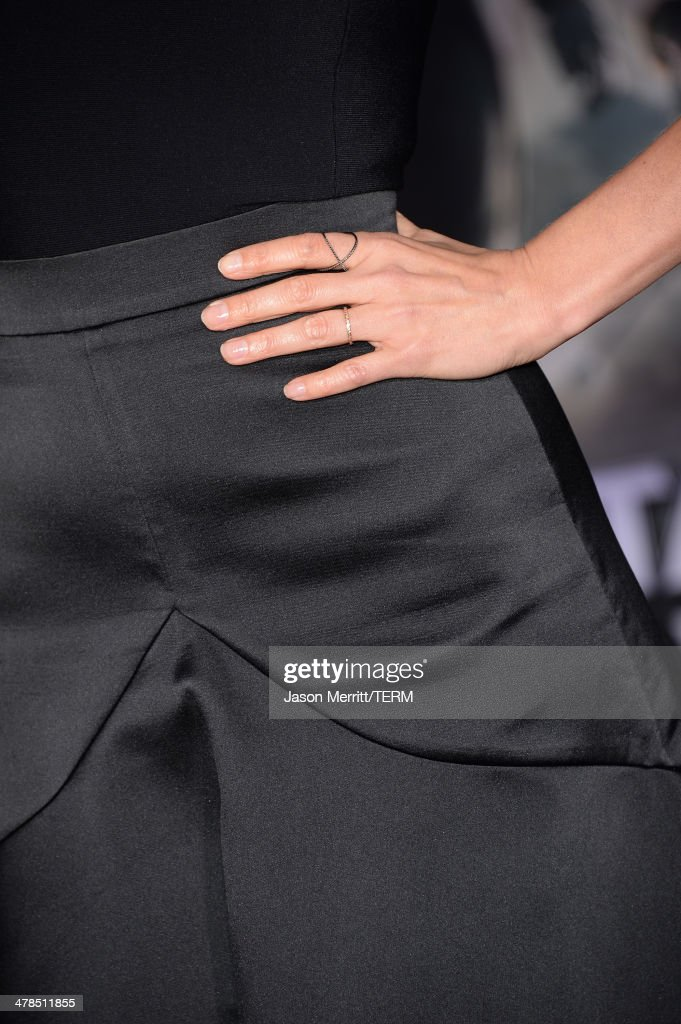Actress Cobie Smulders (jewelry detail) arrives for the premiere of Marvel's 'Captain America: The Winter Soldier' at the El Capitan Theatre on March 13, 2014 in Hollywood, California.