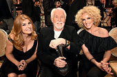 Actress Connie Britton singersongwriter Kenny Rogers and Kimberly Schlapman of Little Big Town attend the 2015 'CMT Artists of the Year' at...