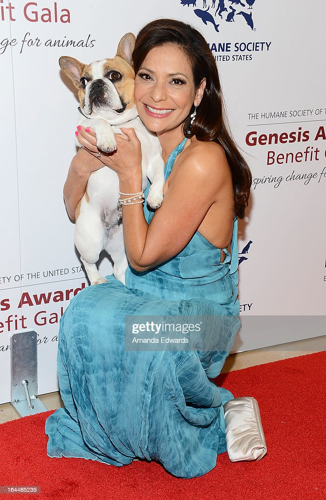 Actress Constance Marie and Beatrice the dog arrive at The Humane Society's 2013 Genesis Awards Benefit Gala at The Beverly Hilton Hotel on March 23, 2013 in Beverly Hills, California.