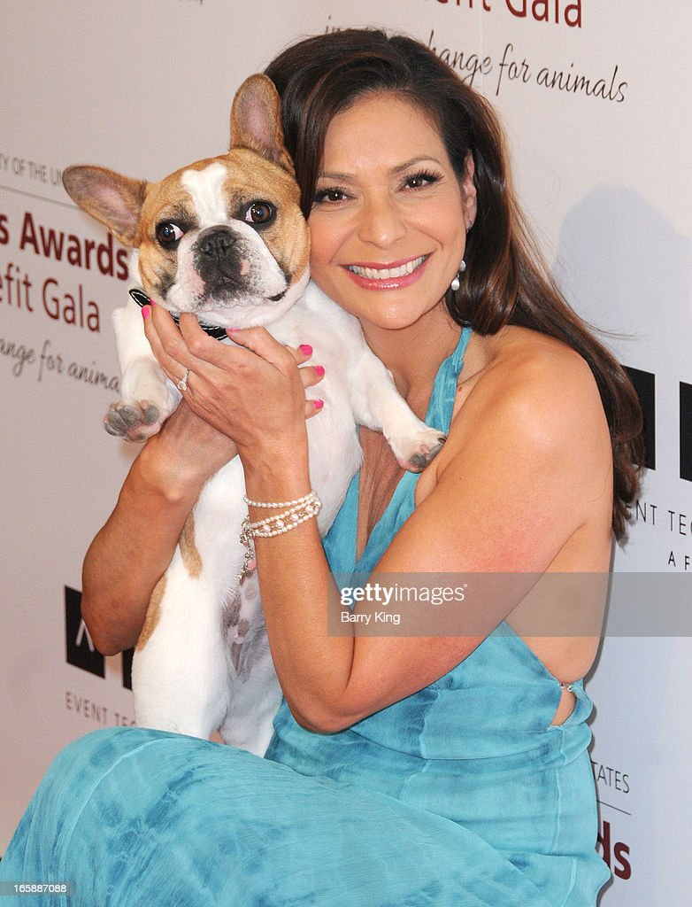 Actress Constance Marie and Beatrice the dog attend The Humane Society's 2013 Genesis Awards benefit gala at the Beverly Hilton Hotel on March 23, 2013 in Beverly Hills, California.