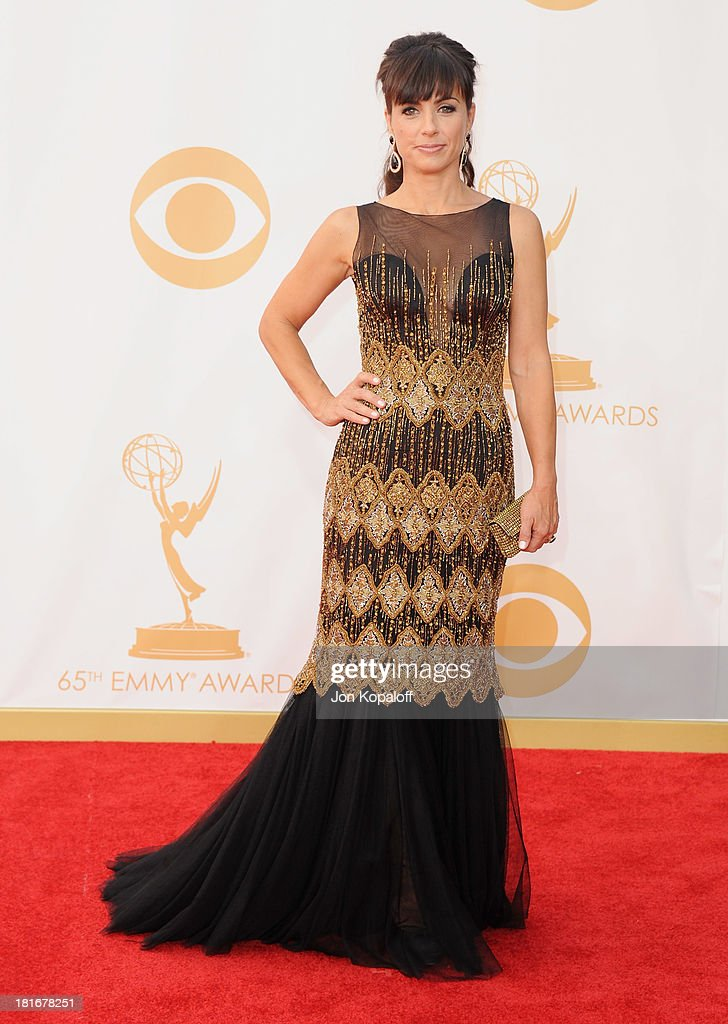 Actress <a gi-track='captionPersonalityLinkClicked' href=/galleries/search?phrase=Constance+Zimmer&family=editorial&specificpeople=217359 ng-click='$event.stopPropagation()'>Constance Zimmer</a> arrives at the 65th Annual Primetime Emmy Awards at Nokia Theatre L.A. Live on September 22, 2013 in Los Angeles, California.