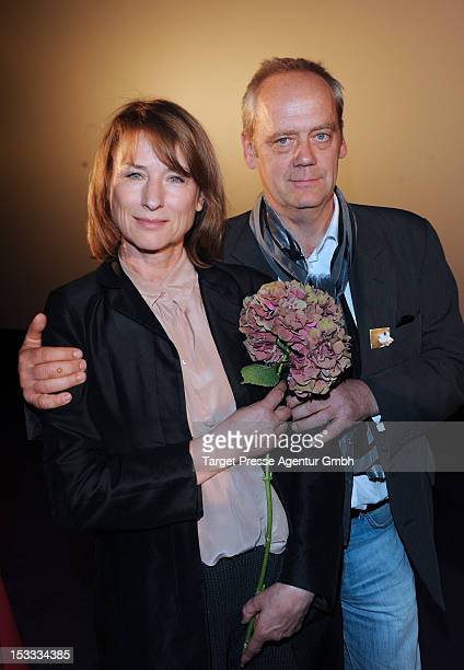 Actress Corinna Harfouch and Actor HansHeinrich Hardt attends the premiere of the movie '3 Zimmer Kueche Bad' at 'Kulturbrauerei' on October 3 2012...