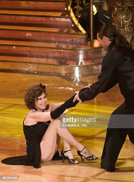 Actress Corinne Clery and her dance partner Chuck Danza perform during the tv show 'Strictly Come Dancing' on March 7 2009 in Rome Italy