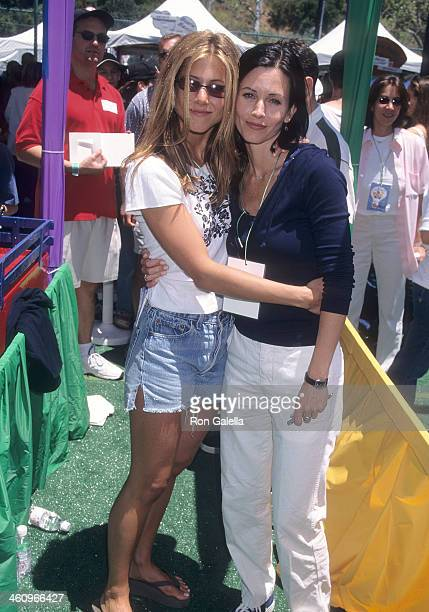 Actress Courteney Cox and actress Jennifer Aniston attend the Ninth Annual 'A Time for Heroes' Celebrity Carnival to Benefit the Elizabeth Glaser...