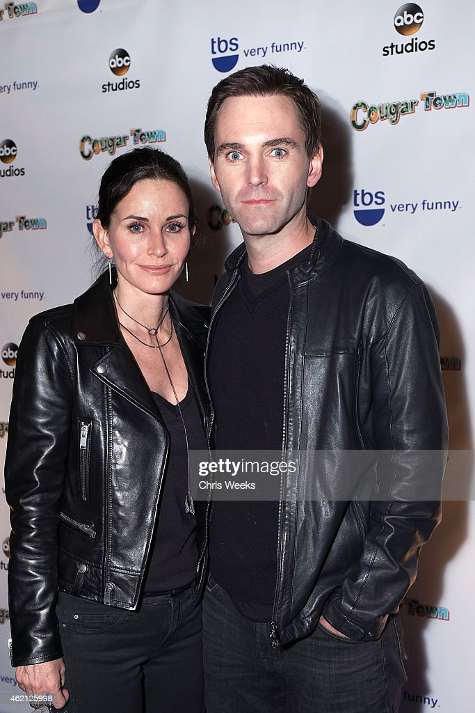 Actress <a gi-track='captionPersonalityLinkClicked' href=/galleries/search?phrase=Courteney+Cox&family=editorial&specificpeople=203101 ng-click='$event.stopPropagation()'>Courteney Cox</a> and <a gi-track='captionPersonalityLinkClicked' href=/galleries/search?phrase=Johnny+McDaid+-+Musicien&family=editorial&specificpeople=12322239 ng-click='$event.stopPropagation()'>Johnny McDaid</a> attend the Cougar Town wrap party at RivaBella on January 24, 2015 in West Hollywood, California.