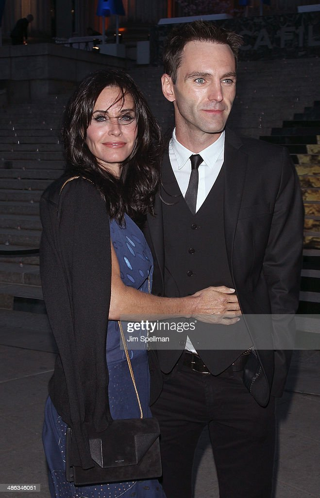Actress <a gi-track='captionPersonalityLinkClicked' href=/galleries/search?phrase=Courteney+Cox&family=editorial&specificpeople=203101 ng-click='$event.stopPropagation()'>Courteney Cox</a> and <a gi-track='captionPersonalityLinkClicked' href=/galleries/search?phrase=Johnny+McDaid+-+Musician&family=editorial&specificpeople=12322239 ng-click='$event.stopPropagation()'>Johnny McDaid</a> attend the Vanity Fair Party during the 2014 Tribeca Film Festival at The State Supreme Courthouse on April 23, 2014 in New York City.