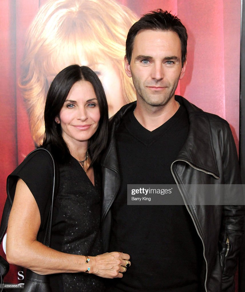Actress <a gi-track='captionPersonalityLinkClicked' href=/galleries/search?phrase=Courteney+Cox&family=editorial&specificpeople=203101 ng-click='$event.stopPropagation()'>Courteney Cox</a> and musician <a gi-track='captionPersonalityLinkClicked' href=/galleries/search?phrase=Johnny+McDaid+-+Musicista&family=editorial&specificpeople=12322239 ng-click='$event.stopPropagation()'>Johnny McDaid</a> arrive at the season premiere of HBO's 'The Comeback' held at the El Capitan Theatre on November 5, 2014 in Hollywood, California.