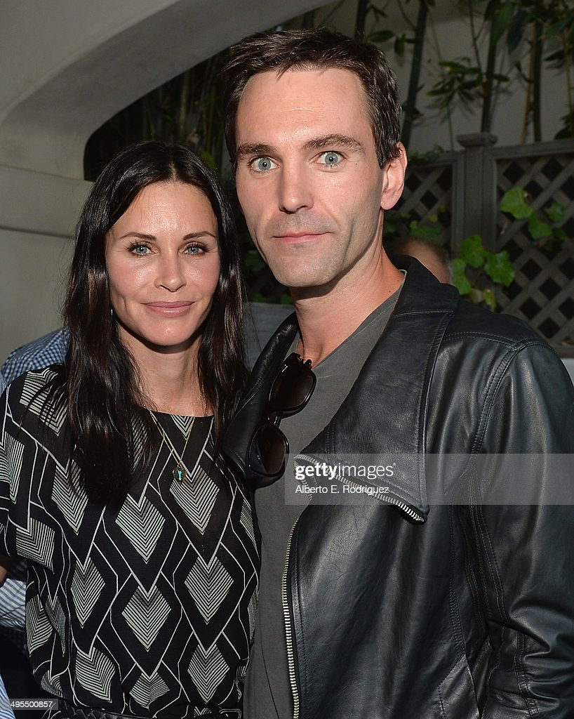Actress <a gi-track='captionPersonalityLinkClicked' href=/galleries/search?phrase=Courteney+Cox&family=editorial&specificpeople=203101 ng-click='$event.stopPropagation()'>Courteney Cox</a> and songwriter Johnny McDaid attend Kevin Morris' 'White Man's Problem' book release party on June 3, 2014 in Los Angeles, California.