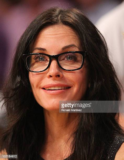 Actress Courteney Cox watches Game Seven of the 2010 NBA Finals at Staples Center between the Boston Celtics and the Los Angeles Lakers on June 17...