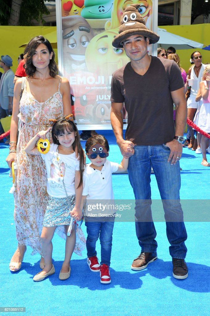Actress Courtney Laine Mazza, Gia Francesca Lopez, Dominic Lopez and tv personality Mario Lopez attend the premiere of Columbia Pictures and Sony Pictures Animation's 'The Emoji Movie' at Regency Village Theatre on July 23, 2017 in Westwood, California.