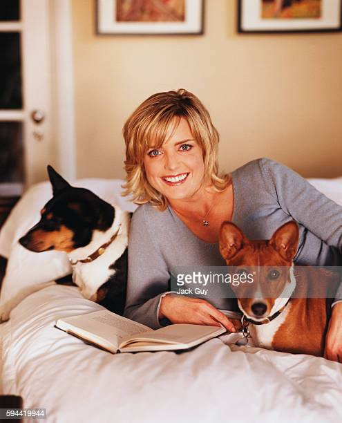 Actress Courtney ThorneSmith is photographed with her dogs for InStyle in 2002 at home in Los Angeles California
