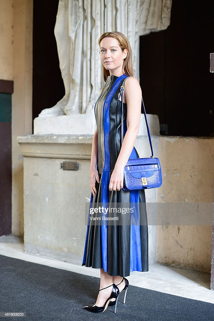 Actress <a gi-track='captionPersonalityLinkClicked' href=/galleries/search?phrase=Cristiana+Capotondi&family=editorial&specificpeople=676919 ng-click='$event.stopPropagation()'>Cristiana Capotondi</a> poses wearing a Vionnet dress and bag and Casadei shoes before Vionnet show on July 9, 2014 in Paris, France.