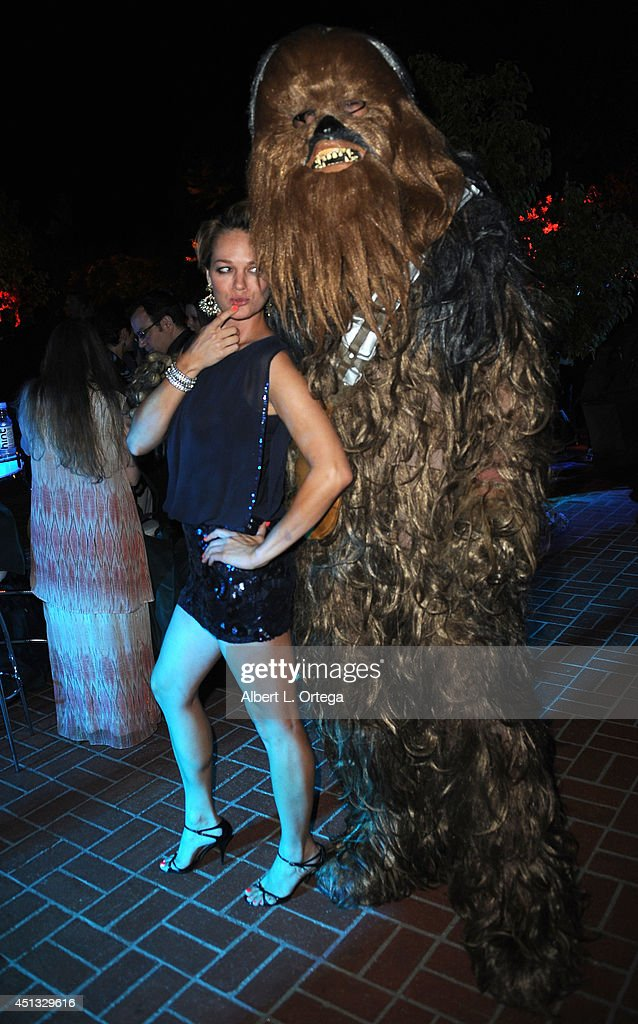 Actress Crystal Allen poses with Chewbacca at the After Party for the 40th Annual Saturn Awards held at on June 26, 2014 in Burbank, California.