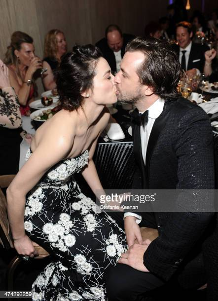 Actress Crystal Reed and TV host Darren McMullen attends the 16th Costume Designers Guild Awards with presenting sponsor Lacoste at The Beverly...