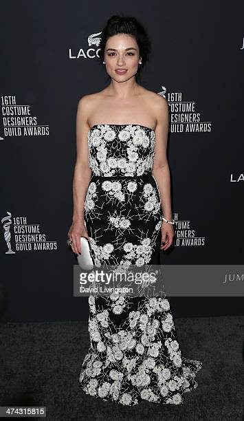 Actress Crystal Reed attends the 16th Costume Designers Guild Awards with presenting sponsor Lacoste at The Beverly Hilton Hotel on February 22 2014...