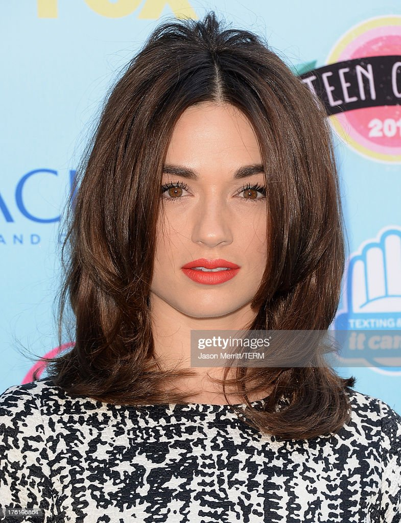 Actress Crystal Reed attends the Teen Choice Awards 2013 at Gibson Amphitheatre on August 11, 2013 in Universal City, California.