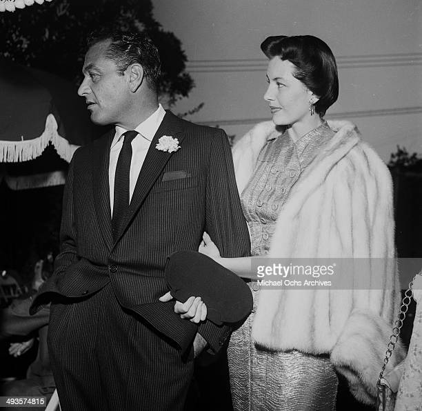 Actress Cyd Charisse with her husband Tony Martin attend a dinner party in Los Angeles California