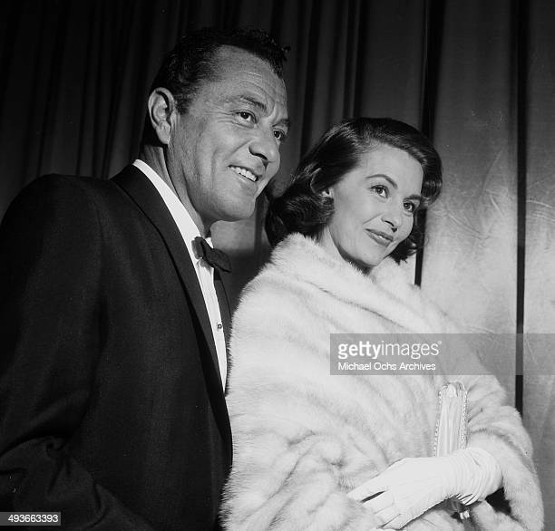 Actress Cyd Charisse with her husband Tony Martin attend the premiere of 'Designing Women' in Los Angeles California