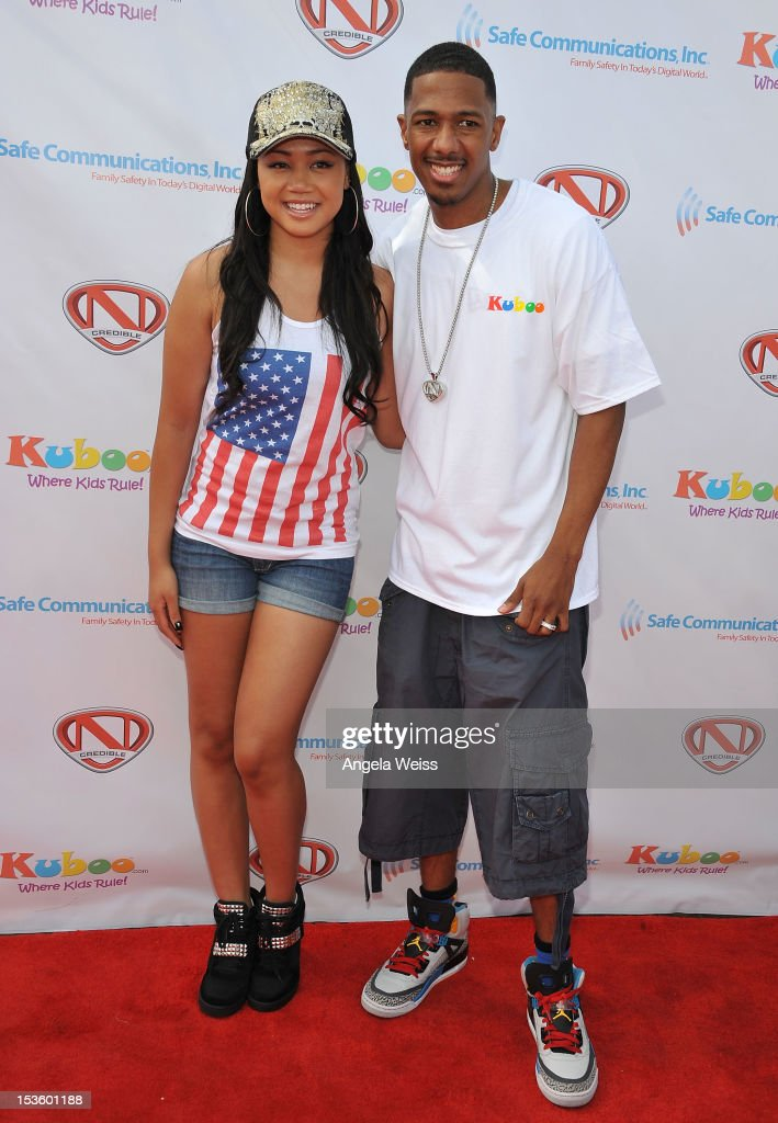 Actress Cymphonique Miller and TV personality <a gi-track='captionPersonalityLinkClicked' href=/galleries/search?phrase=Nick+Cannon&family=editorial&specificpeople=202208 ng-click='$event.stopPropagation()'>Nick Cannon</a> arrive at 'Family Day' hosted by <a gi-track='captionPersonalityLinkClicked' href=/galleries/search?phrase=Nick+Cannon&family=editorial&specificpeople=202208 ng-click='$event.stopPropagation()'>Nick Cannon</a> at Santa Monica Pier on October 6, 2012 in Santa Monica, California.