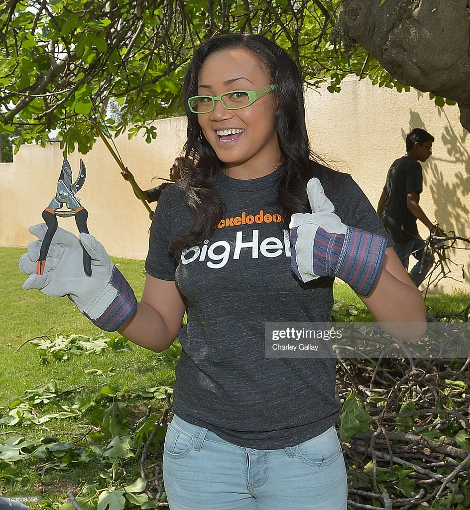Actress Cymphonique Miller from Nickelodeon's 'How to Rock' volunteers with students for a Big Help environmental project at New Horizon Elementary & Middle School on April 30, 2012 in Pasadena, California.