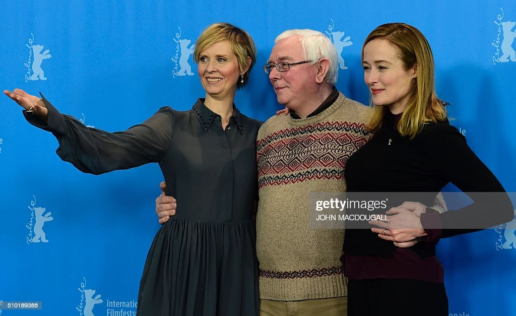 US actress Cynthia Nixon, British director Terence Davies and US actress Jennifer Ehle pose during a photocall for the film 'A Quiet Passion' during the 66th Berlinale Film Festival in Berlin on February 14, 2016. / AFP / John MACDOUGALL