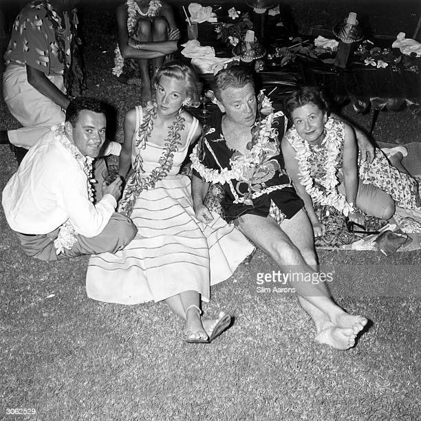 Actress Cynthia Stone and her husband Jack Lemmon with James Cagney and his wife Frances 'Bill' Vernon at a party held in Honolulu for the cast of...