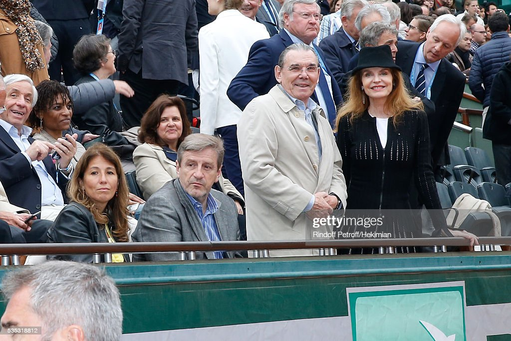 Actress Cyrielle Clair (R) and her husband President of Forest Hill Michel Corbiere (2nd R) attend Day Height of the 2016 French Tennis Open at Roland Garros on May 29, 2016 in Paris, France.