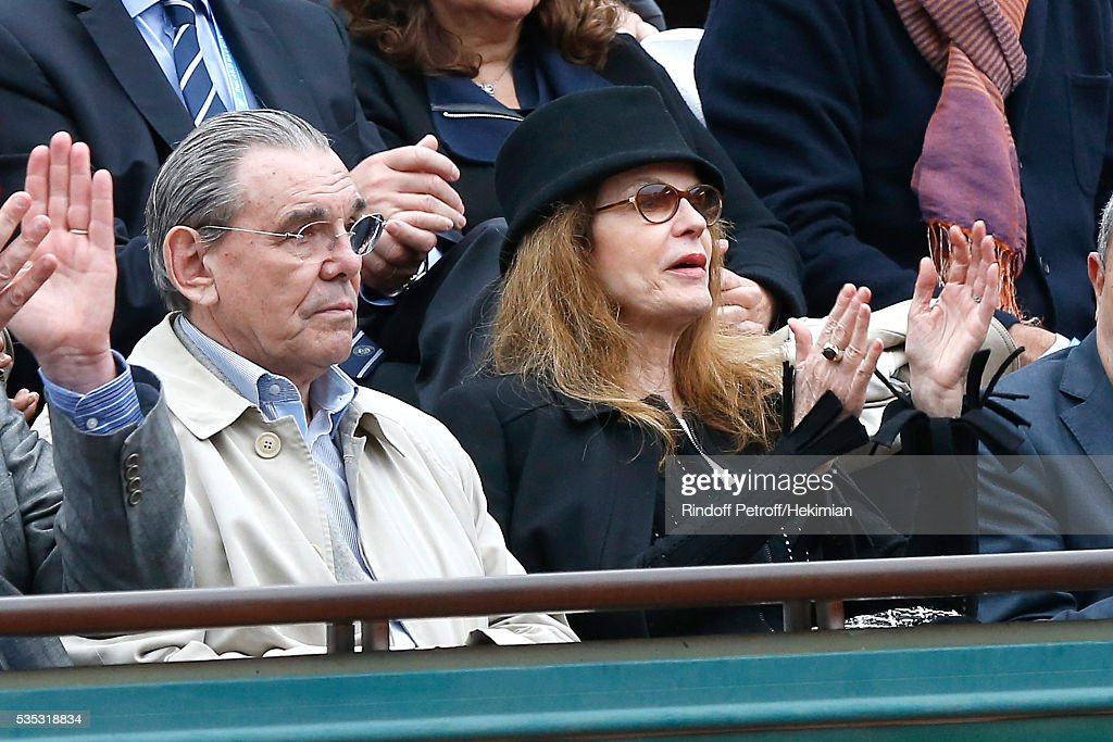 Actress Cyrielle Clair (R) and her husband President of Forest Hill Michel Corbiere (L) attend Day Height of the 2016 French Tennis Open at Roland Garros on May 29, 2016 in Paris, France.
