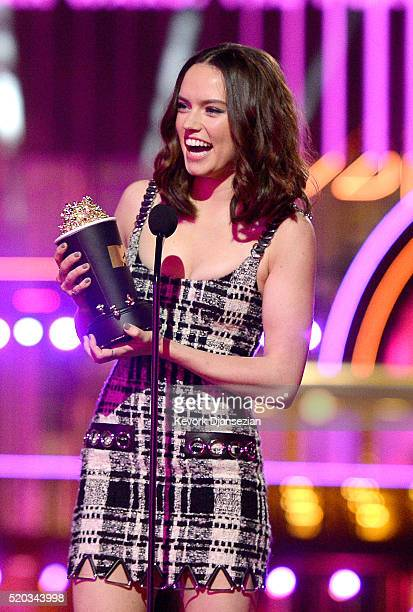 Actress Daisy Ridley accepts the Movie of the Year award for 'Star Wars The Force Awakens' onstage during the 2016 MTV Movie Awards at Warner Bros...