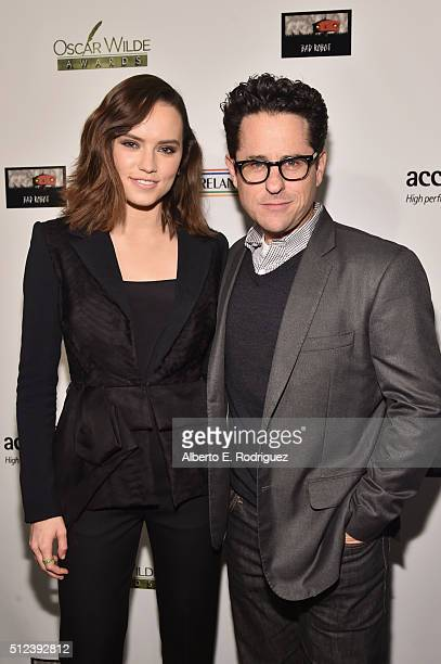 Actress Daisy Ridley and director JJ Abrams attend the Oscar Wilde Awards at Bad Robot on February 25 2016 in Santa Monica California