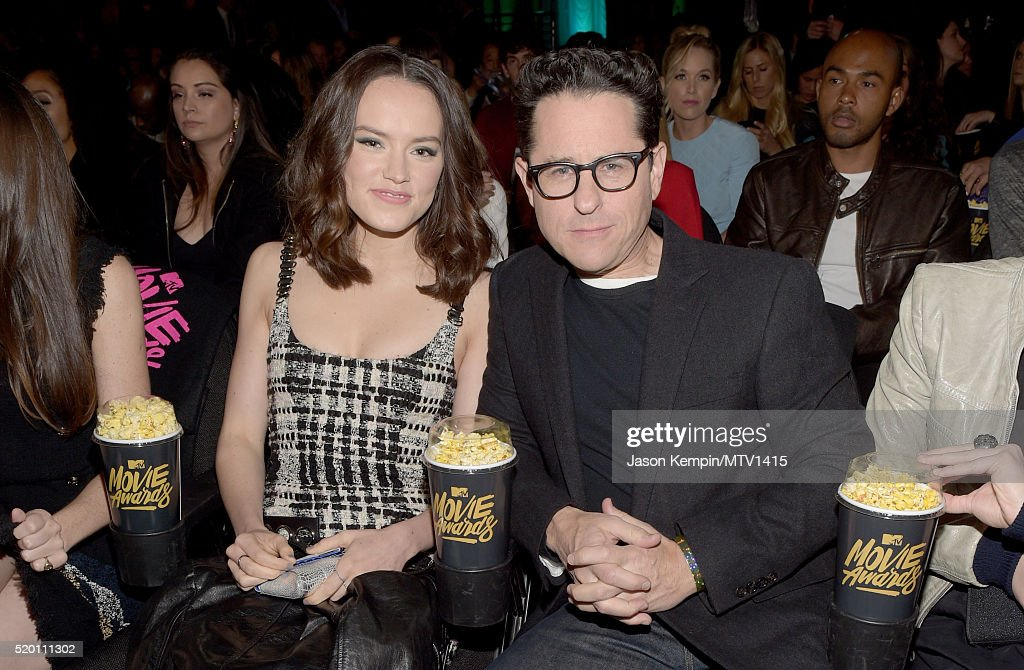 actress-daisy-ridley-and-filmmaker-jj-abrams-pose-in-the-audience-picture-id520111302