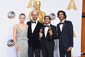 Actress Daisy Ridley filmmakers James GayRees Asif Kapadia winners of the Best Documentary Feature award for 'Amy' and Dev Patel pose in the press...