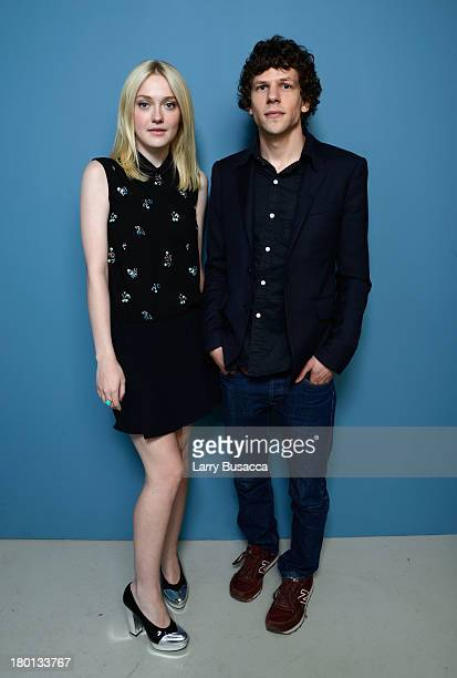 Actress Dakota Fanning and Jesse Eisenberg of 'Night Moves' pose at the Guess Portrait Studio during 2013 Toronto International Film Festival on...