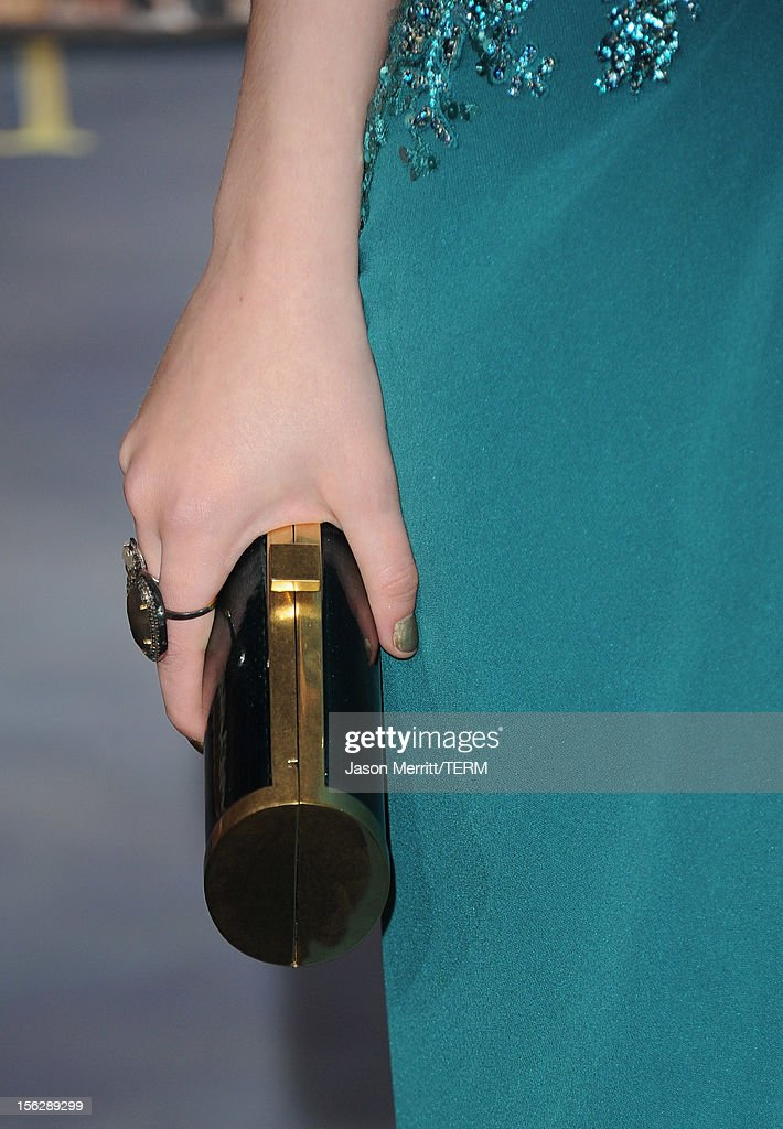 Actress Dakota Fanning (clutch detail) arrives at the premiere of Summit Entertainment's 'The Twilight Saga: Breaking Dawn - Part 2' at Nokia Theatre L.A. Live on November 12, 2012 in Los Angeles, California.