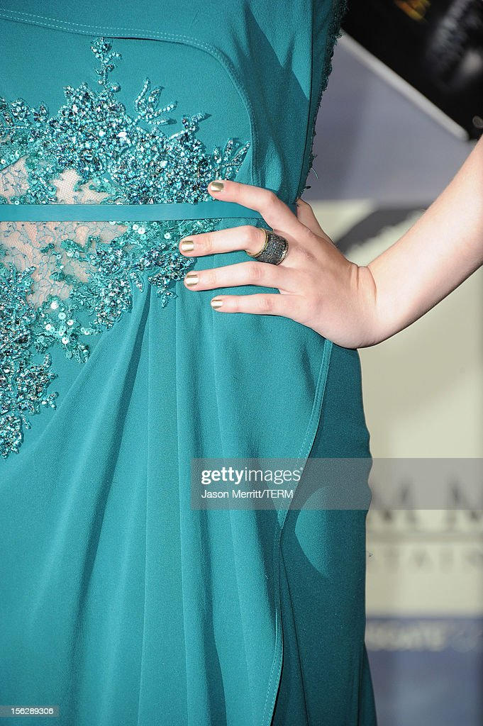 Actress Dakota Fanning (ring detail) arrives at the premiere of Summit Entertainment's 'The Twilight Saga: Breaking Dawn - Part 2' at Nokia Theatre L.A. Live on November 12, 2012 in Los Angeles, California.
