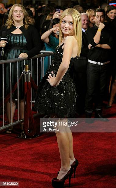 Actress Dakota Fanning arrives at 'The Twilight Saga New Moon' premiere held at the Mann Village Theatre on November 16 2009 in Westwood California